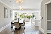Dining table and glass wall in open-plan interior