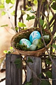 Dyed eggs with leaf patterns in Easter basket