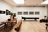 Gallery of pictures and sculptural furniture in artist's apartment