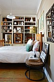 Collection of curiosities on shelves in bedroom