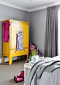 Yellow, Asian wardrobe in a gray children's room