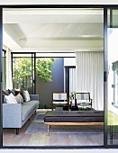 View into living room with glass walls