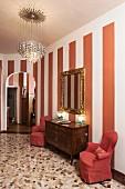 Terrazzo floor, striped wall and classic furniture in hallway