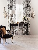Desk and Baroque chair in front of window with floor-length curtains