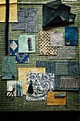 Mood board of fabrics in shades of blue and green