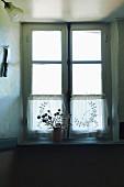 An old transom window, backlit