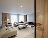 Elegant sofa set and coffee table set in living room with recessed spotlights in suspended ceiling