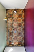 Traditional wall tiles on back wall of shower with side walls in different colours