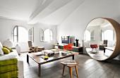 Large round designer mirror in living area