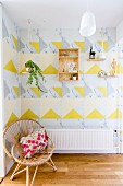 Graphic design of yellow and marbled triangles on wall