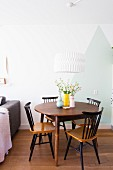 Round wooden chair and old Windsor chairs