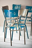 White and white metal chairs painted and labelled using templates