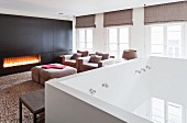 Gas fire in elegant lounge on gallery with white balustrade
