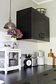 Modern kitchen in black with vintage accessories
