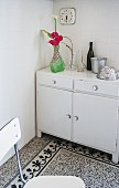 Old cabinet and terrazzo floor in white kitchen