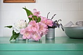 Peony, lilies and lavender in old tin cans