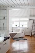 Comfortable living room in wooden cabin