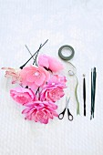 Artificial flowers, tape and scissors