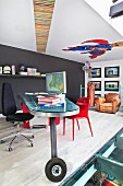 Designer desk on wheels on gallery with comic-book mural on ceiling