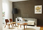 Classic chair, coffee table, sofa and standard lamp in front of brown wall in living room