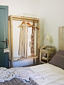 Open clothes rack in Mediterranean bedroom