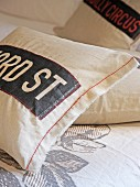 Vintage-style cushions cover with appliqué lettering