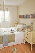 Antique bedside cabinet in bedroom in natural shades