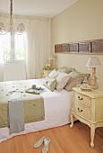 Antique bedside cabinet in bedroom in natural shades