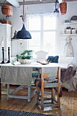 Rustic furniture and textiles in shabby-chic dining room