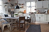 Rustic dining table in white, country-house-style kitchen-dining room