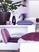 Modern living room with purple and violet accessories