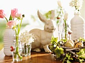 Easter arrangement with bottles used as vases and bunny ornament