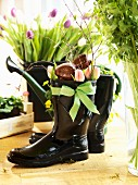 Chocolate Easter bunny and tulips in black Wellington boots
