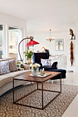 Cubic metal-framed coffee table on patterned rug