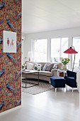 Peacock-patterned wallpaper in bright vintage living room