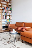 Comfortable leather couch next to bookcase