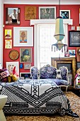 Mixture of patterns and gallery of pictures in opulent bedroom