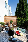 Summery terrace of contemporary terrace house with screen