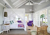 Canopy bed in bedroom of summery beach house