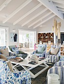 Armchairs with various upholstery in living room of beach house