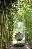 Artwork made from glass and mirror in bamboo garden