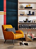 Cognac-brown leather armchair in front of shelves of ornaments