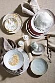 Fine ceramic crockery in powdery shades on linen tablecloth