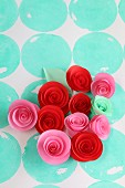 Paper flowers on polka-dot surface