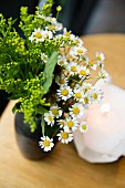 Daisies as a table decoration at the Kadeau restaurant in Copenhagen, Denmark