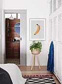 Bedroom with white built-in wardrobe and retro flair, view of bathroom ensuite