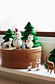 Winter arrangement of snowmen and fir tree ornaments