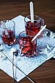 Glasses of cranberry drinks festively served on napkin