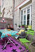 Colourful garden furniture and road signs in courtyard