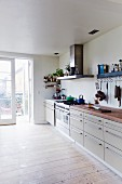 Simple kitchen counter in bright room with wooden floor